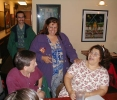 Previous: Shaun Piron in a green jacket in the back, Alan Frisbie in the front, Rebecca Barber, Marina Stern laughing.