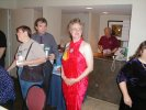 """Previous: Kathleen Meyer, David Lee Anderson, Joan Palfi (Con Suite) in red, """"Bear"""" (Chuck) behind counter."""