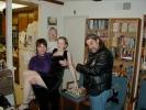Lisa Murway holds up Mariel Massoglia while Kris...