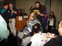 Previous: Con Suite. Gregg Reynante talking with Fred Lazzelle, others.