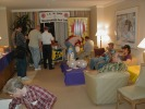 "Previous: Dennis McCunney foraging in the ice chest foreground left; Jim Briggs and Len Wein on the couch, Craig Miller in comfy chair foreground right. This is the ""L.A. in 2006 Salutes Con José Guest of Honor Vernor Vinge: Macarooned in Real Time"" party."