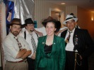 Next: Some of the Lux Radio Theater Players. Shawn Crosby at left, Dave Hogan, Colleen Crosby in green, John Bryson in black pinstriped suit. Scott and Michael obscured behind Colleen and John.