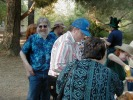 Next: Alan Rosenthal in blue shirt with greying beard, Bob Daverin in brimmed hat in background, Randy Smith in a blue cap, Priscilla, Kevin in silly green hat, Crickett Fox in green shirt with mustard.