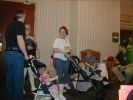 Previous: David Means, Cary Osborne, little Maura Means in the first stroller, Marisa Means, Iain Means in the second stroller, Mary Kay Kare sitting in the chair, Erik V. Olson off on the right.