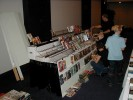 Previous: This video dealer had his wares on display in front of his table, as well as on top of it. You can see the aisles aren\
