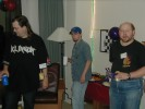"Previous: Jerry Gieseke in a black ""Klingon"" t-shirt, someone in a blue cap and plaid shirt, and Louis Zimmerman, in the Seattle party."