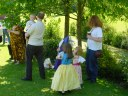 Jonathan Cain carried by his daddy Steven, Marianne Cain in dark blue, Charlotte Taylor in yellow skirt, Tilly with red sash, and someone else at right. (01-Jun-2002)