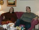Previous: Joyce Katz, Arnie Katz, on their couch.
