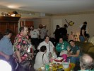Previous: Crowd of people in the L.A. in 2006 party, including Shawn Crosby at left, Ed Green, Blars in the very back of the room next to Tony Benoun center back with hat, various people seated including Chris Newman waving at the camera, and Craig Miller\
