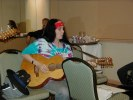 Previous: Leslie Fish, performing in the Filk Room.