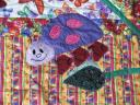 Previous: Detail of the baby blanket. Dorothy hand-embroidered the details on the bug\